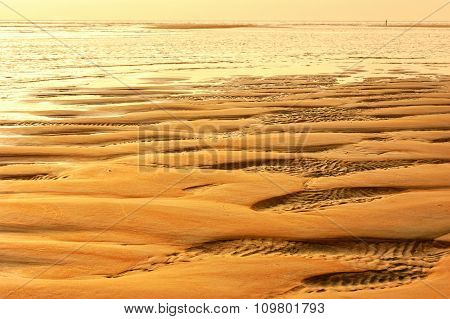 Tropical beach in ebb time on sunset background Mobor Beach South Goa India.