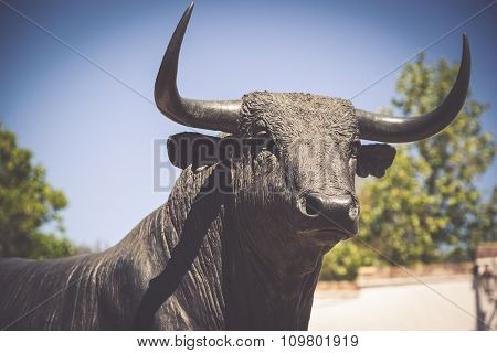 Bull Statue In Front Of The Bullfighting Arena In Ronda, Spain