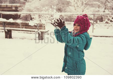 Happy Little Girl Playing With Snow