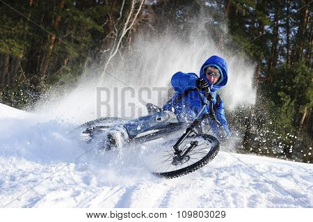 Winter cyclist in snow