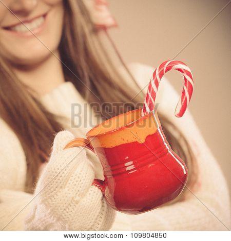 Girl Hands Holding Mug And Cane.