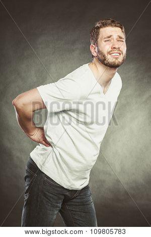 Man Suffering From Backache Back Pain.