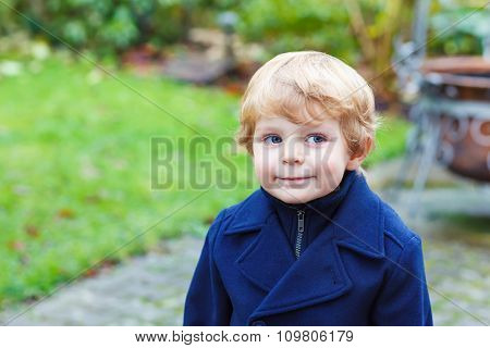 Portrait of little toddler boy on autumn day