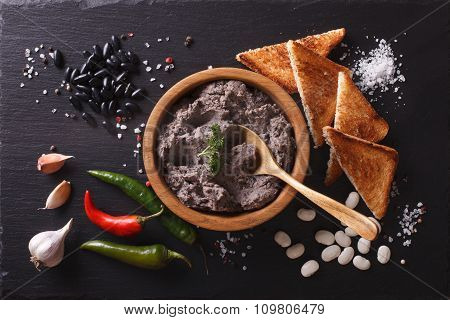 Mexican Cuisine: Pate Of Black Beans On The Table. Horizontal Top View