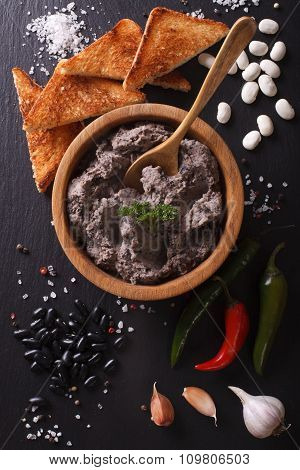 Mexican Cuisine: Pate Of Black Beans Close Up. Vertical Top View