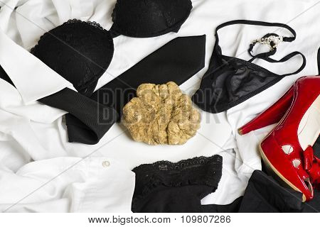 White Truffle Of Piedmont On The Bed With Underwear And Clothing