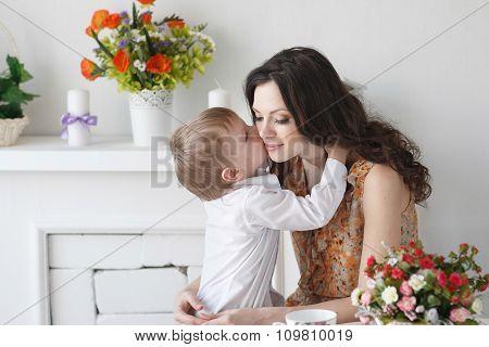 Beautiful Blond Boy Kissing A Girl Mom