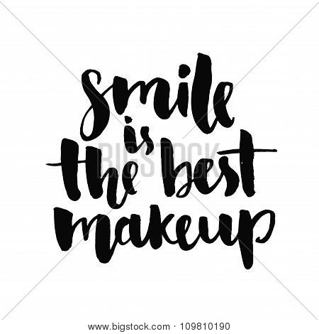 Smile is the best makeup. Inspirational quote handwritten with black ink and brush, custom lettering