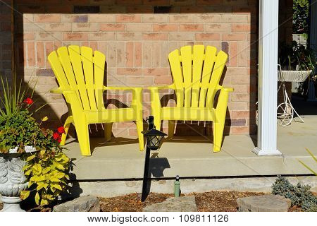Two Yellow Wooden Chairs.