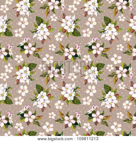 Seamless floral background with watercolour drawing apple flowers on brown polka dots backdrop