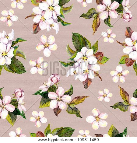 Vintage seamless floral pattern with watercolor painted retro apple tree flowers on old paper backgr