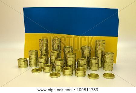 Golden coins and Ukrainian flag