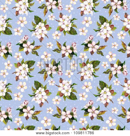 Seamless floral repeated backdrop with aquarelle drawing - apple tree flowers on blue background