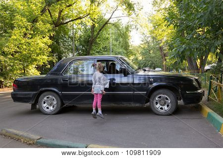 Little Girl Jumps To Window To See Sitting In The Car Grandpa