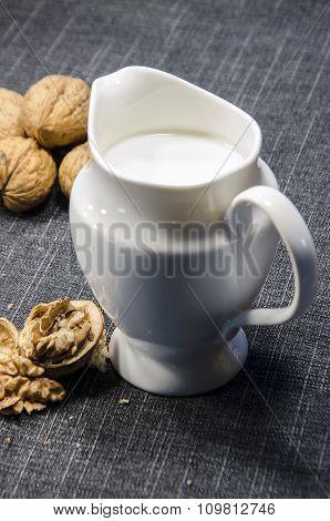 Jug Of Milk And Walnuts