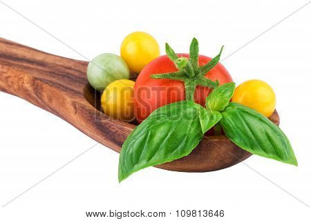 Tomatoes on Wooden Spoon Close-up