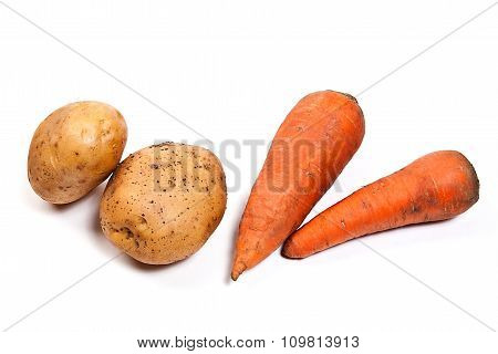Potatoes And Carrots Isolated On White.