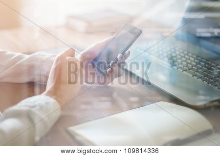Woman using mobile phone in office workplace