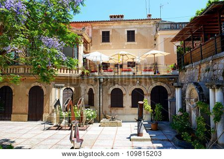 The Building With Outdoor Restaurant On Terrace In Soller, Mallorca Island, Spain