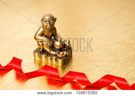 Monkey The Symbol Of The New Year 2016, And Red Satin Ribbon