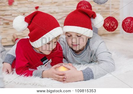 Two Little Child Santa Embracing