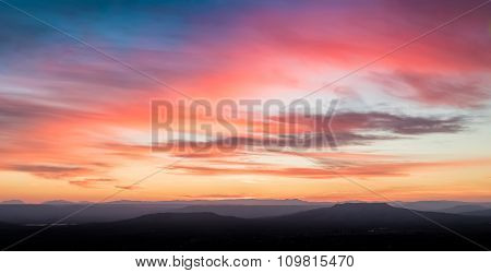 Sunset Scene With Mountains In Background