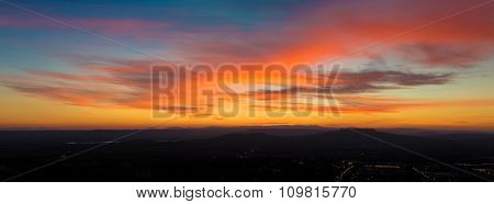 Panoramic View Of Sunset Scene With Mountains In Background