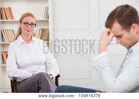 Professional female therapist is serving her patient