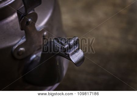 old kettle on a grunge wooden surface