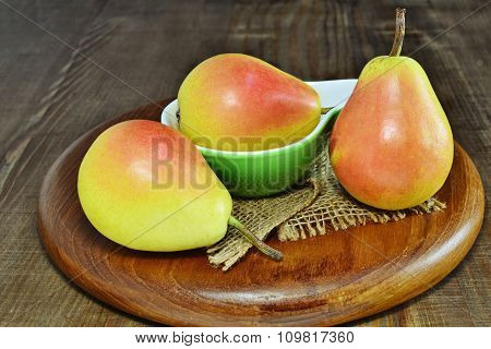 Three Ripe Pears Over Wooden Board. Santa Maria Pears