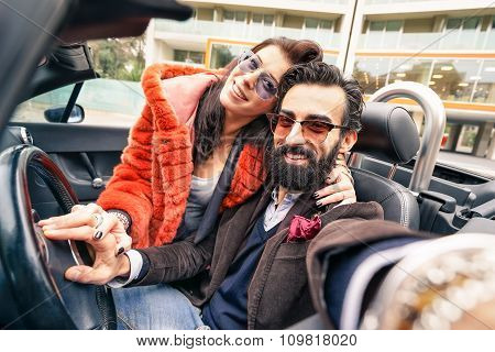 Handsome Hipster Boyfriend Having Fun With Girlfriend - Happy Couple Taking Selfie At Car Trip