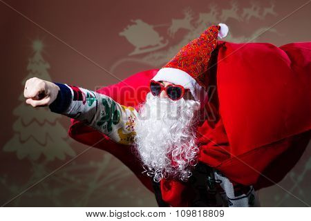 Funky Santa Claus wearing heart shape sunglasses and red shawl
