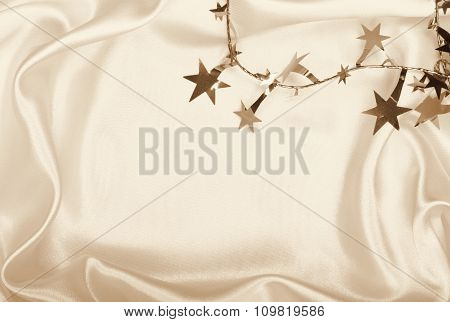 Golden Stars And Spangles On Silk As Background. In Sepia Toned. Retro Style