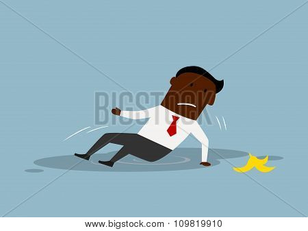 Cartoon businessman slipped on a banana peel