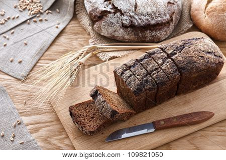 Sliced black bread on a wooden table