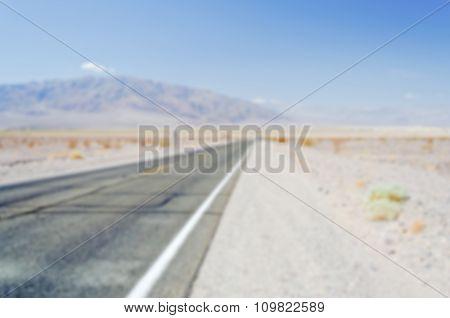 Defocused Background Of  Desert Road In Death Valley, California