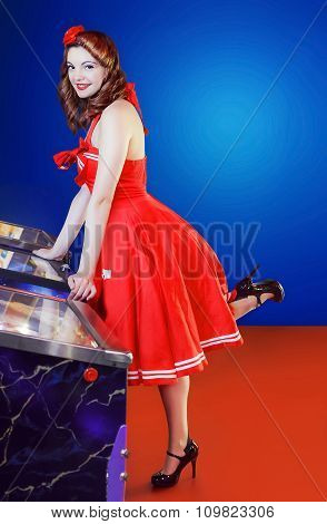 Style Pinup Girl In Red Dress, Play Pinball.