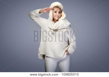 Beautiful Blonde Lady Wearing Cap And Sweater.