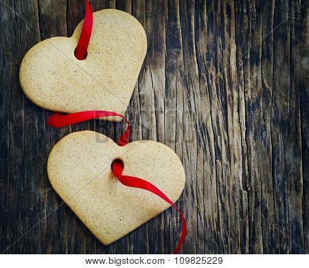 Ginger Cookies In The Shape Of Hearts On Wooden Background