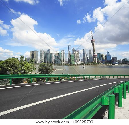 Empty Road Surface With Shanghai Bund City Buildings