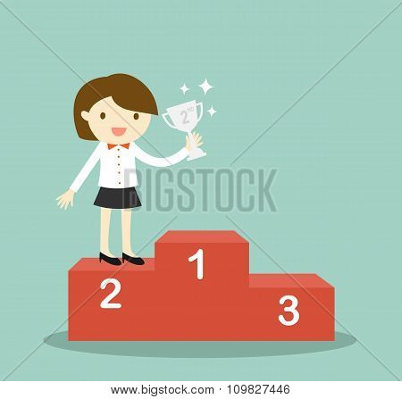 Business concept, business woman standing on 2nd winning podium and holding silver trophy.