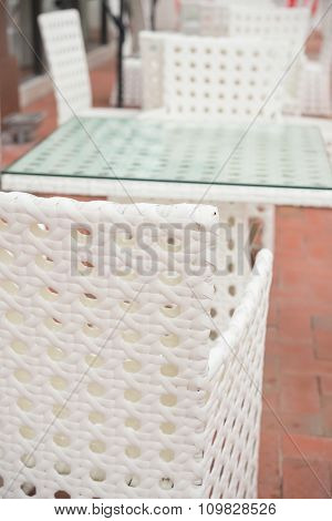 White Rattan Sofa And Table Sets In Outdoor Vertical Composition