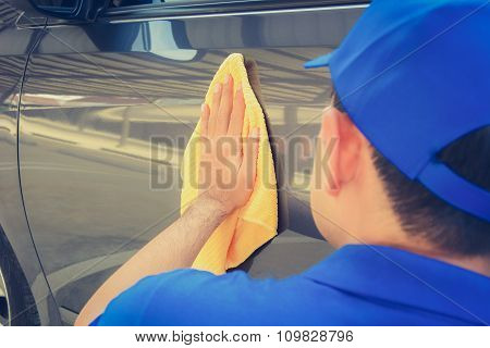 A Man Polishing Car With Microfiber Cloth, Car Detailing (or Valeting) Concept