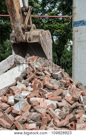 Excavator Demolishing Concrete And Brick Rubble Debris Vertical