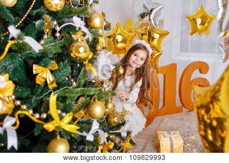 Girl Hiding Behind Christmas Tree. New Year 2016.
