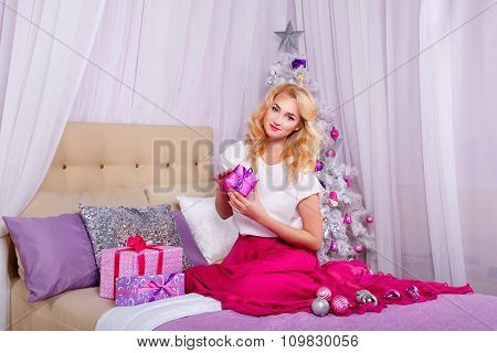 Girl Sitting On The Couch And Preparing Christmas Gifts.