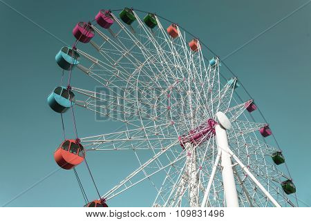 Colorful Giant Ferris Wheel Against Sky, Vintage Style
