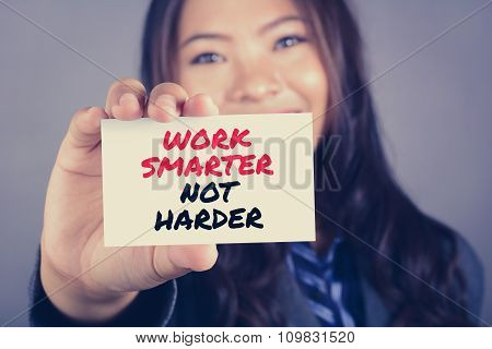 Businesswoman Showing Card With A Message Work Smarter Not Harder