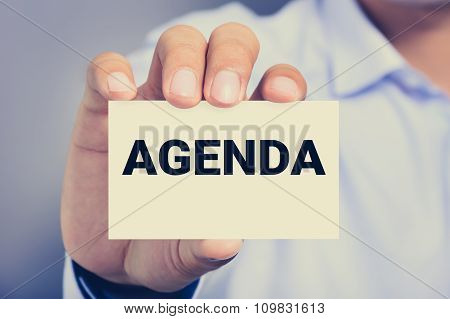 Agenda Word On The Card Shown By A Man
