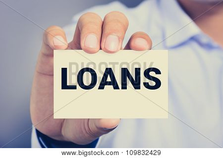 Loans Word On The Card Shown By A Man, Vintage Tone